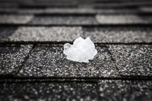 Picture of hail on a shingle roof.
